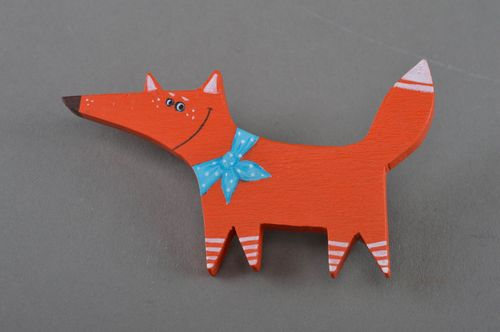 Handmade small painted wooden brooch in the shape of red fox with blue bow - MADEheart.com