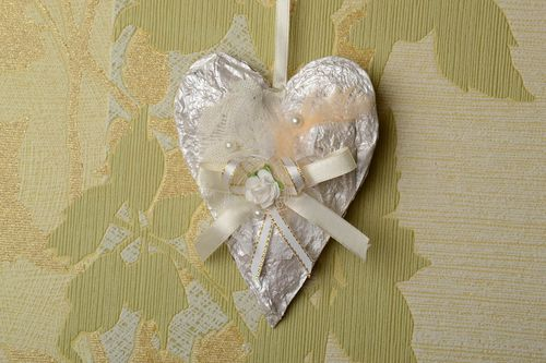 Handmade white heart-shaped carton wall hanging decorated with ribbons  - MADEheart.com