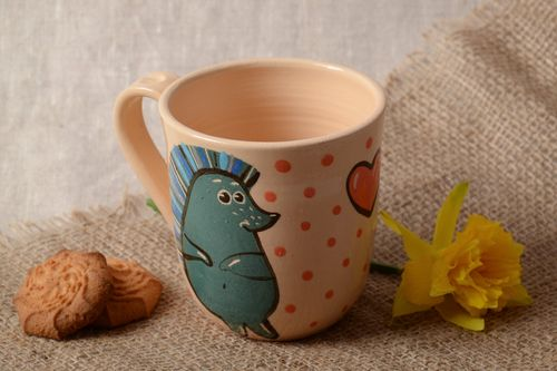 Handmade enameled and glazed ceramic cup of pink color with painted hedgehog - MADEheart.com
