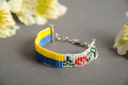 Handmade designer thin bead woven yellow and blue wrist bracelet with flowers - MADEheart.com