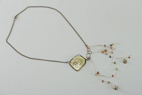 Handmade botanical pendant on long chain with real flowers coated with epoxy - MADEheart.com