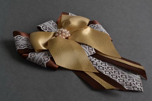 Handmade designer satin ribbon brooch in the shape of bow in brown color palette - MADEheart.com