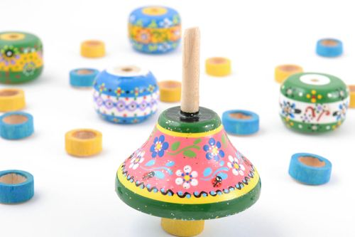 Bright painted small handmade childrens wooden spinning top - MADEheart.com