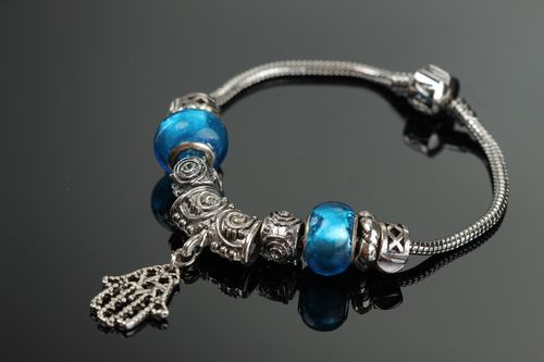 Thin handmade wrist bracelet with blue glass beads and metal charm for women - MADEheart.com