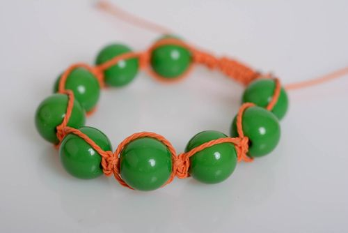 Handmade bracelet with plastic beads on waxed cord green-orange accessory - MADEheart.com