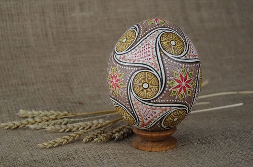 Easter egg painted with hot wax Suastica with triquetrums - MADEheart.com