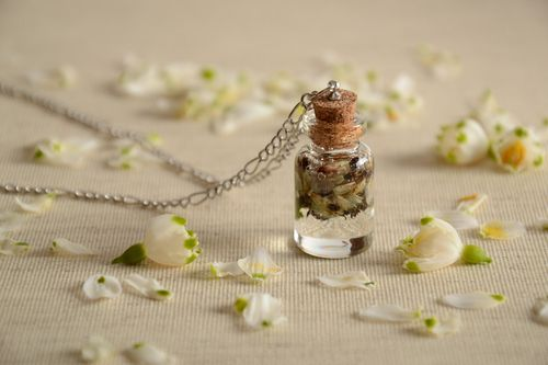 Handmade neck pendant with real flowers coated with epoxy in the shape of transparent vial - MADEheart.com