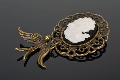 Vintage metal brooch with cameo and swallow - MADEheart.com