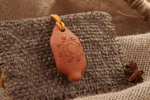 Tin whistle pendant made of clay with flower - MADEheart.com