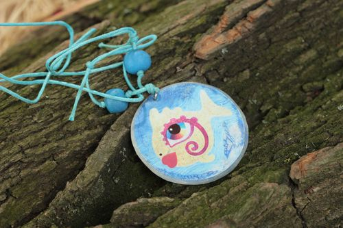 Handmade round shape pendant with blue fish print made of polymer clay - MADEheart.com