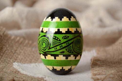 Green and black handmade painted goose egg ornamented using waxing technique - MADEheart.com