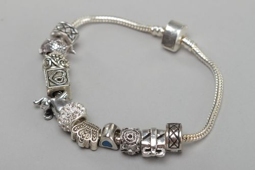 Handmade wrist bracelet with metal beads of different shapes for women - MADEheart.com