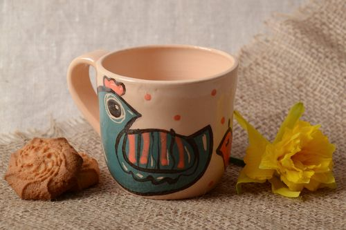 Unusual clay cup painted with enamel and covered with glaze with drawing of birdies - MADEheart.com