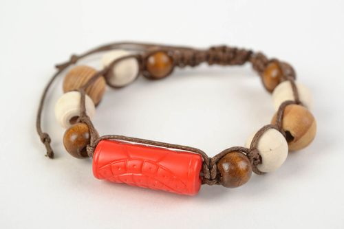 Handmade stylish bracelet with large wooden beads woven of cord red and brown - MADEheart.com