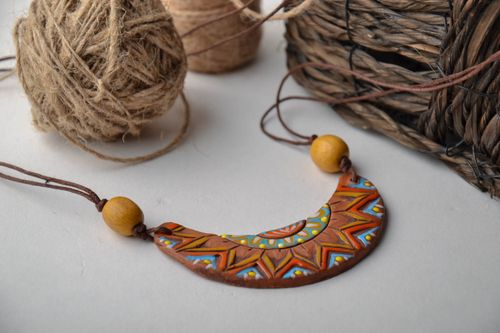 Ceramic pendant in the shape of half moon - MADEheart.com