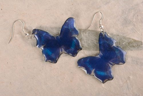 Unusual handmade blue butterfly shaped earrings coated with epoxy resin - MADEheart.com