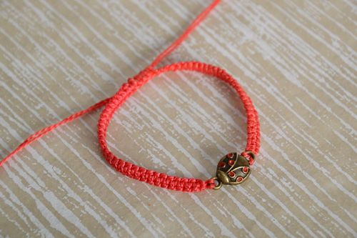 Handmade womens macrame woven cord bracelet of red color with charm - MADEheart.com