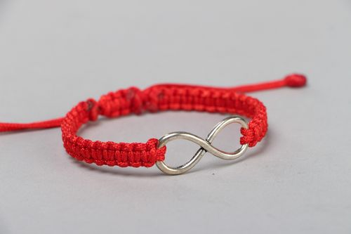 Handmade wrist friendship bracelet with synthetic cord of red color Eternity - MADEheart.com