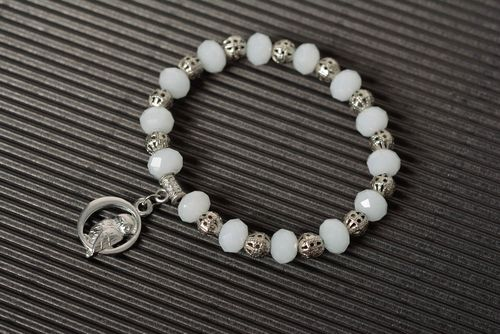 Handmade wrist bracelet with white plastic beads and metal charm for women - MADEheart.com