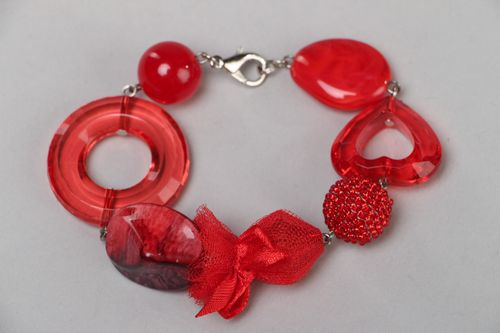 Handmade bright red wrist bracelet with plastic beads and metal fastener - MADEheart.com