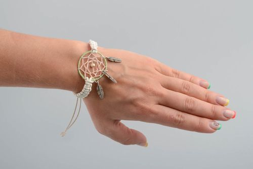 Handmade light macrame woven cord wrist bracelet with dreamcatcher and charms - MADEheart.com