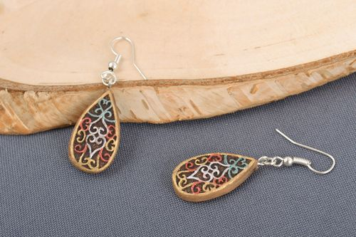 Handmade small drop-shaped ceramic dangling earrings with painted ornaments  - MADEheart.com