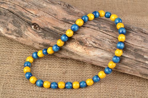 Unusual bright beautiful wooden bead necklace - MADEheart.com