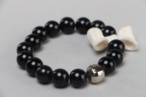 Handmade wrist bracelet with black plastic beads and white polymer clay bow - MADEheart.com