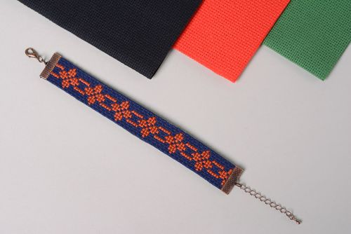 Handmade womens wrist bracelet with ethnic embroidery on dark blue background - MADEheart.com
