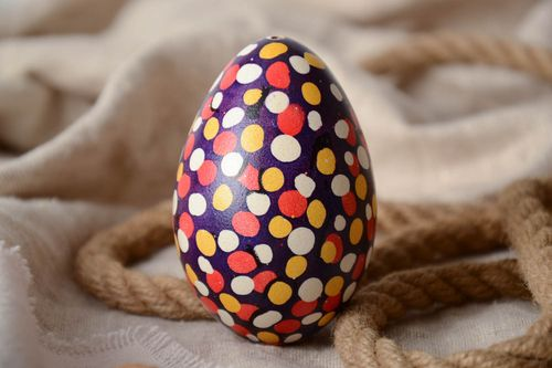 Handmade unusual Easter egg with colorful polka dot pattern on dark background - MADEheart.com