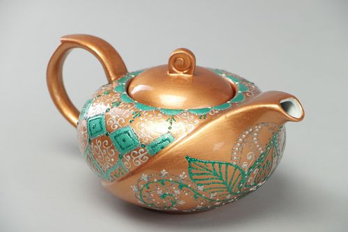 Handmade decorative ceramic teapot painted with ornaments on golden background - MADEheart.com