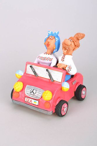 Clay figurine Cossack and his Wife in a Car - MADEheart.com