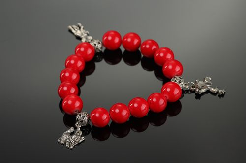 Handmade wrist bracelet with charms and beads of artificial coral for women - MADEheart.com
