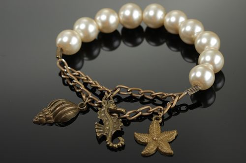 Elegant handmade bracelet with artificial pearls and metal charms for women - MADEheart.com