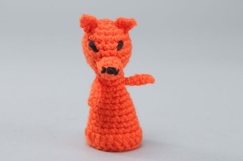 Small handmade finger puppet crocheted of acrylic threads in the shape of red fox - MADEheart.com