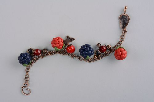 Plastic bracelet with charms in the shape of berries - MADEheart.com