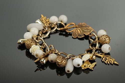 Handmade womens wrist bracelet with charms and beads of white and gold color - MADEheart.com