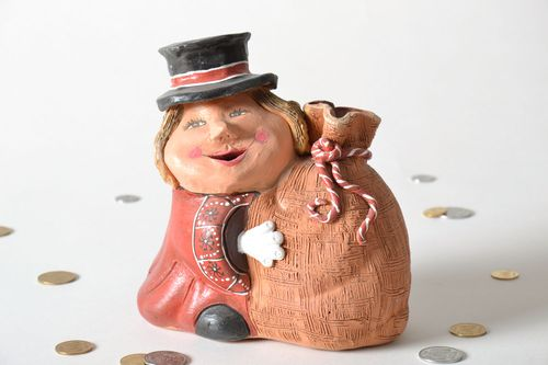 Ceramic money box in the shape of a man with a bag - MADEheart.com