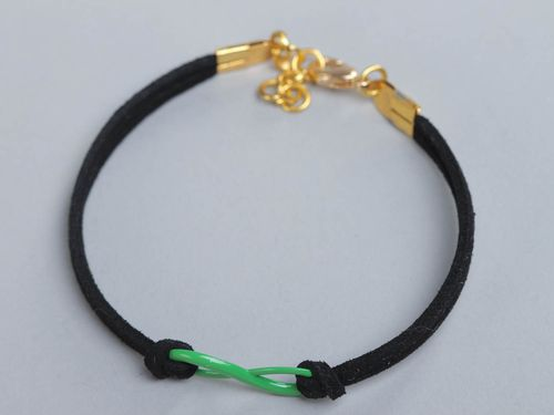 Unusual handmade woven suede wrist bracelet with charm for girls - MADEheart.com