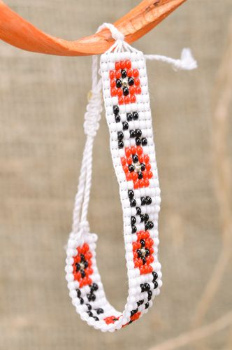 Handmade wrist bracelet woven of black white and red beads with ethnic ornament - MADEheart.com