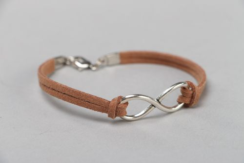 Handmade thin brown friendship bracelet woven of faux suede cord with charm - MADEheart.com
