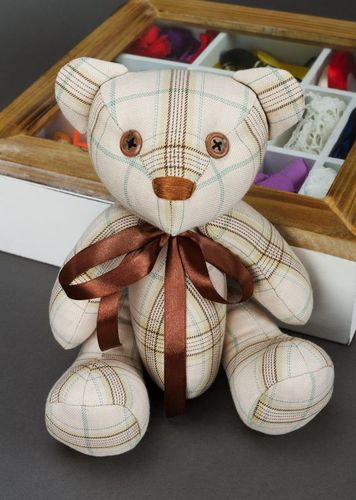 Soft childrens toy bear with bow on neck and paws fixed on hinges - MADEheart.com