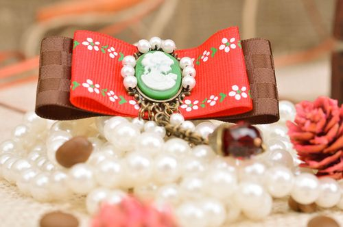 Handmade vintage rep ribbon brooch with cameo and beads in red and brown colors - MADEheart.com