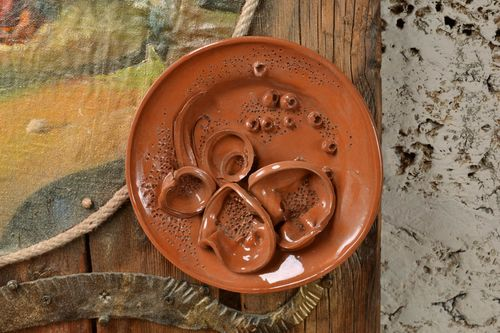 Decorative wall plate made of clay with molding brown handmade beautiful pottery - MADEheart.com