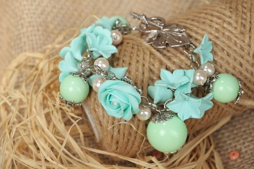 Handmade beautiful designer flower bracelet with charms made of polymer clay in mint color - MADEheart.com