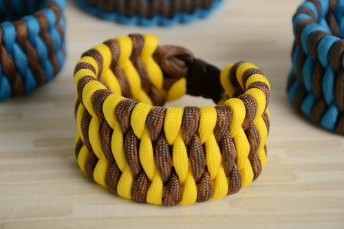 Yellow handmade survival bracelet woven of American paracord - MADEheart.com