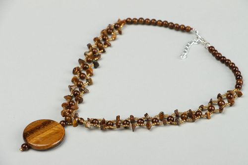 Necklace made of beads and tigers eye stone - MADEheart.com