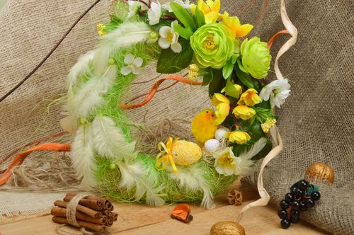 Handmade Easter wreath for home interior made of burlap with green feathers - MADEheart.com