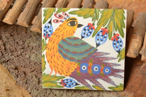 Handmade designer ceramic facing tile with colorful bird painted with engobes - MADEheart.com