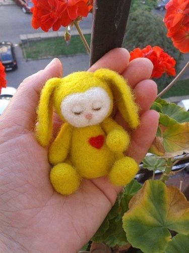 Handmade felted wool soft toy in the shape of yellow hare - MADEheart.com